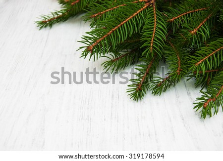 branch of christmas tree on a old wooden background - stock photo