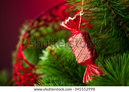 branch of Christmas tree with candy  - stock photo