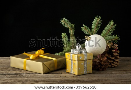 branch of fir-tree and toy for a decoration on a black background - stock photo