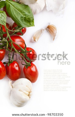 Branch of fresh tomatoes with garlic isolated over white. With sample text
