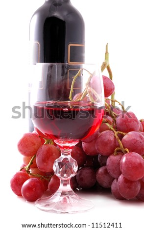 Branch of grapes, bottle of wine and glass on white background