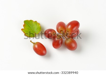 branch of red grapes on white background - stock photo