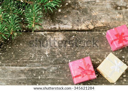 Branches of a Christmas tree on old boards. Christmas background. Christmas decorations. New Year background. Xmax background. Toned image. Falling Snow . - stock photo