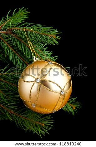branches of fir-tree and decoration on a black background - stock photo