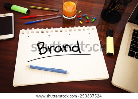 Brand - handwritten text in a notebook on a desk - 3d render illustration. - stock photo