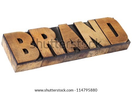 brand - isolated word in vintage letterpress wood type, selective focus - stock photo