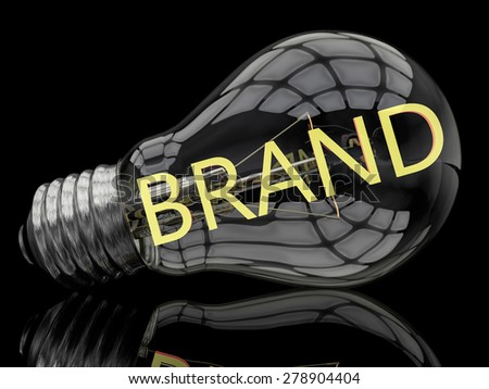 Brand - lightbulb on black background with text in it. 3d render illustration. - stock photo
