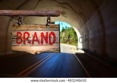 Brand motivational phrase sign on old wood with blurred background