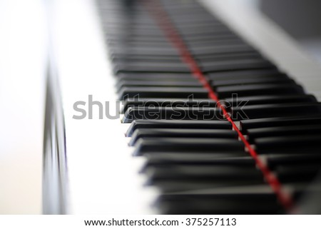 Brand new baby grand keyboard, with a single key in focus