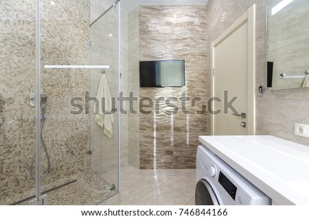 Brand New Bathroom Interior Design. Luxury Modern Bathroom With White Bath  Tub, Washing Machine