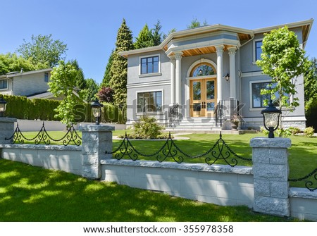 Brand new beautiful family house in suburban of Vancouver. Home for sale. Stylish residential house with wooden door and big front yard.  - stock photo