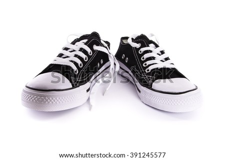 brand new black and white tennis shoes isolated on white background