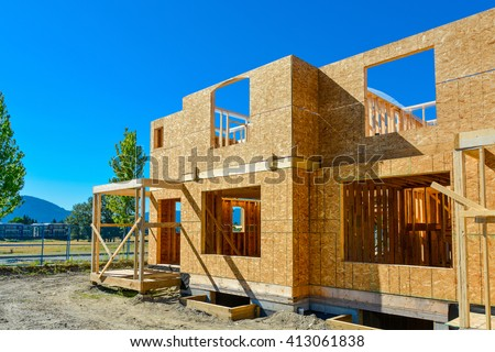 Brand new family house is under construction. - stock photo