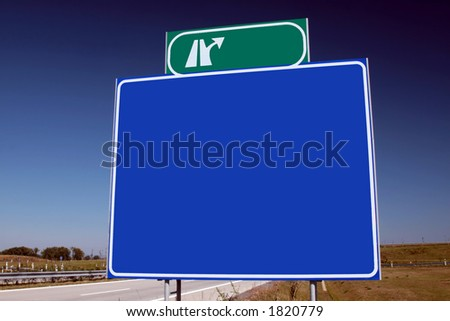 Brand new highway sign and a brilliant blue sky. - stock photo