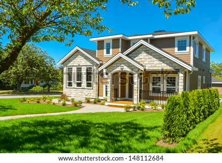 Brand new house for sale. Big luxury house with nicely trimmed and landscaped front yard lawn in the suburbs of Vancouver, Canada.  - stock photo