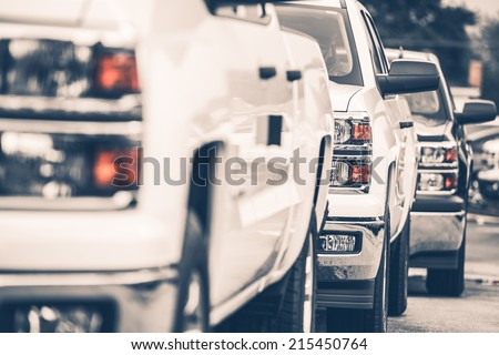 Brand New Pickup Trucks For Sale. Cars Row on the Dealer Lot. - stock photo