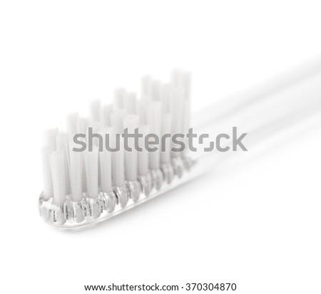 Brand new plastic toothbrush isolated - stock photo
