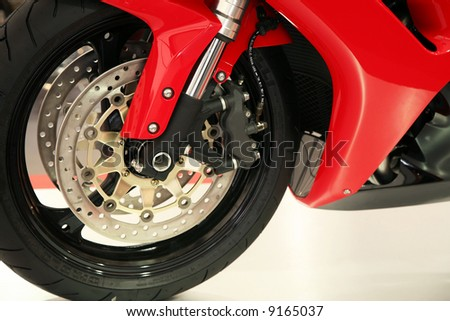 Brand new pure wheel on a red motorcycle