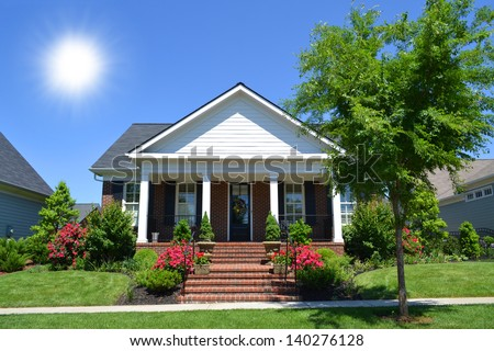 Brand New Suburban American New England Style Dream Home with Large Front Porch - stock photo