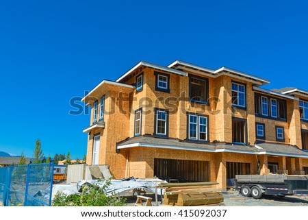 Brand new townhouses building under construction on sunny day in British Columbia, Canada.