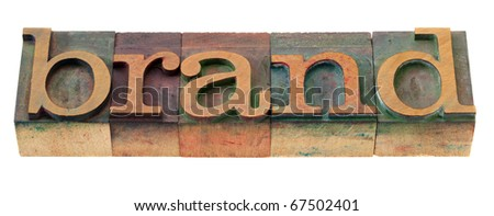 brand word in vintage wooden letterpress printing blocks, stained by color inks, isolated on white - stock photo