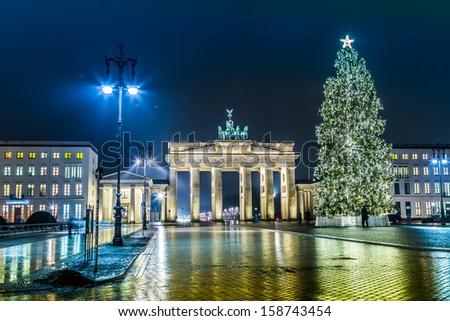 BRANDENBURG GATE, Berlin, Germany at night. Road side view - stock photo