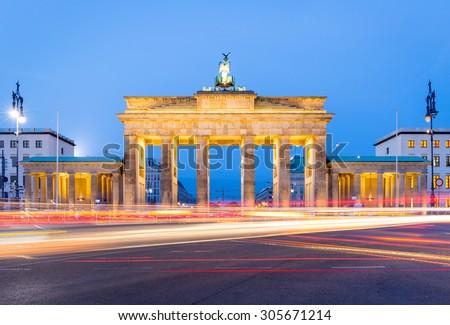 Brandenburg Gate (Brandenburger Tor) at night with car light trails, Berlin - stock photo