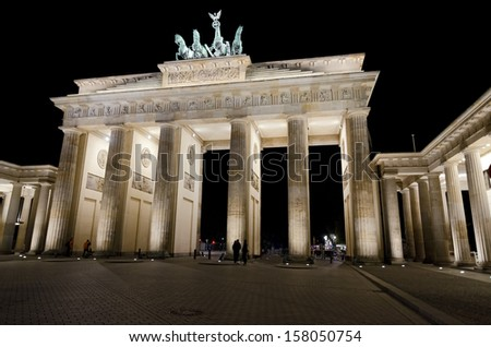 Brandenburg Gate by night, Berlin in Germany. The Brandenburg Gate (German: Brandenburger Tor) is a former city gate and one of the main symbols of Berlin and Germany.