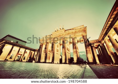 Brandenburg Gate. German Brandenburger Tor in Berlin, Germany. Illumination at night in vintage, retro style - stock photo