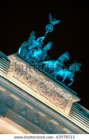 Brandenburg Gate lit by blue light, Berlin, Germany - stock photo