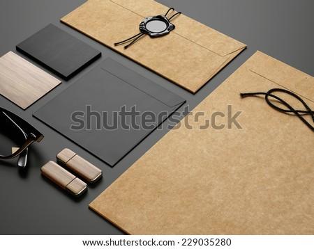 branding elements on black paper background - stock photo