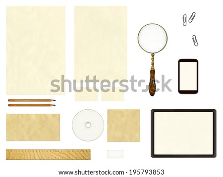 Branding identity template collection. Mock-up including paper, pencils, ruler, magnifier, cd, phone, tablet, clips and eraser isolated on white background.