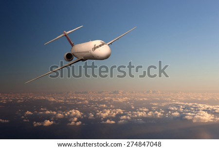 Brandless airplane flying in the clouds - stock photo