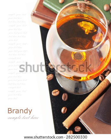 Brandy and cigar isolated on white background - stock photo
