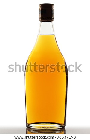 Brandy bottle on a white background. - stock photo