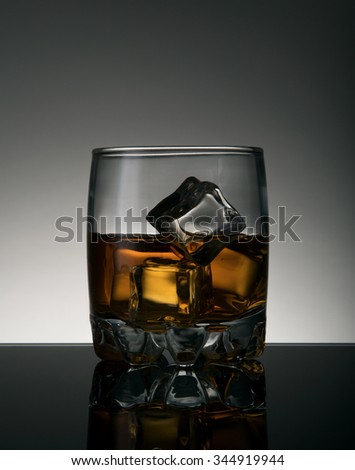 Brandy glass with ice cubes, studio shot