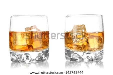 Brandy glasses with ice isolated on white - stock photo