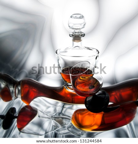 Brandy (whiskey), cognac in a bottle and glass - stock photo