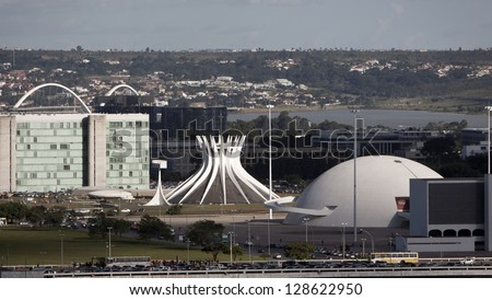 BRASILIA, BRAZIL - FEBRUARY 21: Cathedral of Brasilia and National Museum on February 21, 2009 in Brasilia, Brazil.They were designed by Oscar Niemeyer,one of the greatest architect in modern history. - stock photo
