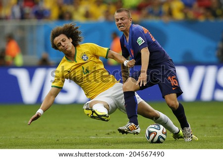 BRASILIA, BRAZIL - JULY 12, 2014: David Luiz of Brazil and Clasie of Netherlands during the World Cup Third place game between Brazil and the Netherlands in the Estadio Nacional. NO USE IN BRAZIL.
