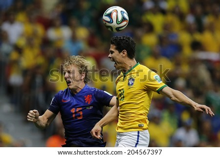 BRASILIA, BRAZIL - JULY 12, 2014: Kuyt of Netherlands and Hernanes of Brazil during the World Cup Third place game between Brazil and the Netherlands in the Estadio Nacional. NO USE IN BRAZIL.