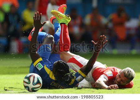 BRASILIA, BRAZIL - June 15, 2014: Caicedo of Ecuador and Behram of Switzerland compete for the ball during the game between Switzerland and Ecuador at Mane Garrincha Stadium. No Use in Brazil.