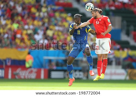 BRASILIA, BRAZIL - June 15, 2014: Caicedo of Ecuador and Rodriguez of Switzerland compete for the ball during the game between Switzerland and Ecuador at Mane Garrincha Stadium. No Use in Brazil.