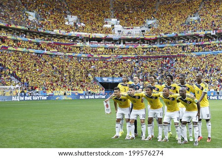 BRASILIA, BRAZIL - June 19, 2014: Colombia team posing for a photo during the FIFA 2014 World Cup. Colombia is facing Ivory Coast in the Group C at Estadio Nacional Mane Garrincha. NO USE IN BRAZIL. - stock photo
