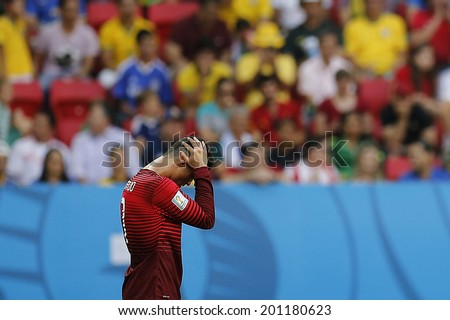BRASILIA, BRAZIL - June 26, 2014: Cristiano Ronaldo on the 2014 World Cup Group G game between Portugal and Ghana at Estadio Nacional Mane Garrincha in Brazil. No Use in Brazil