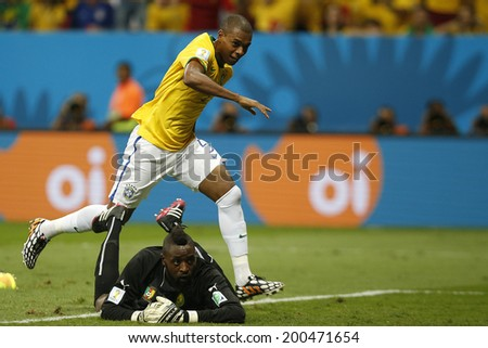 BRASILIA, BRAZIL - June 23, 2014: Fernandinho of Brazil celebrates after scoring a goal during the game between Brazil and Cameroon at Estadio Nacional Mane Garrincha. No Use in Brazil.