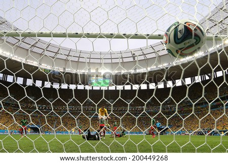 BRASILIA, BRAZIL - June 23, 2014: Fred of Brazil celebrates with Neymar after scoring a goal during the game between Brazil and Cameroon at Estadio Nacional Mane Garrincha. No Use in Brazil. - stock photo