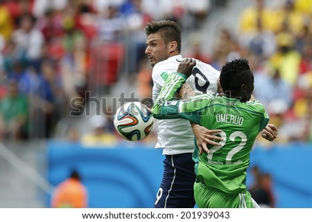 BRASILIA, BRAZIL - June 30, 2014: Giroud of France and Omerou of Nigeria during the 2014 World Cup Round of 16 game between France and Nigeria at Estadio Nacional Mane Garrincha. NO USE IN BRAZIL.