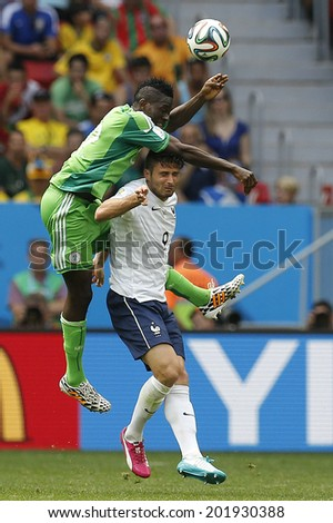 BRASILIA, BRAZIL - June 30, 2014: Giroud of France and Omeruo of Nigeria during the World Cup Round of 16 game between France and Nigeria at Estadio Nacional Mane Garrincha. NO USE IN BRAZIL.