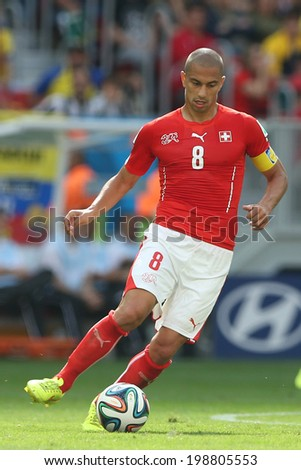 BRASILIA, BRAZIL - June 15, 2014: Gokhan Inler of Switzerland  kicks the ball during the 2014 World Cup Group Group E game between Switzerland and Ecuador at Mane Garrincha Stadium. No Use in Brazil.
